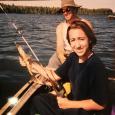 Cori fishing with her dad